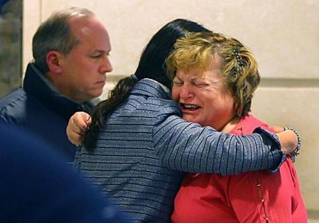 Linda Pelletier was consoled by her attorney, Christine Tennyson, after the hearing as Linda's husband, Lou, looked on.